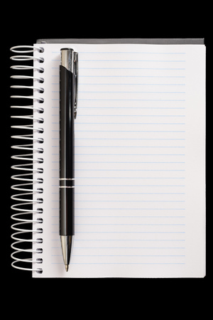 Pen and notepad on black background Imagens