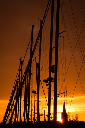 Sunset with sailing boats in Ostend