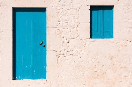 Greek house with blue door and window