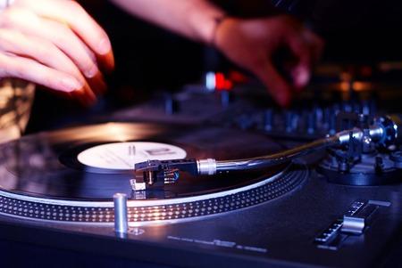 audio mixer: turntable, hand of dj on the vinyl record