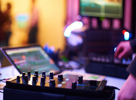 audio mixer: Sound mixing controller for hip hop dj to scratch records,mix live music tracks at night party. Stock Photo