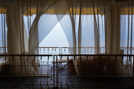 Seaview Restaurant Interior. White Terrace Or Veranda With Separated Cabins Under Tent And White Curtains