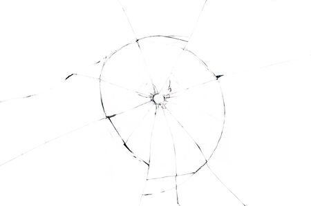 bullet hole in glass close up on white background Stock Photo