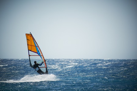 Windsurfing sail on the blue sea Stock Photo