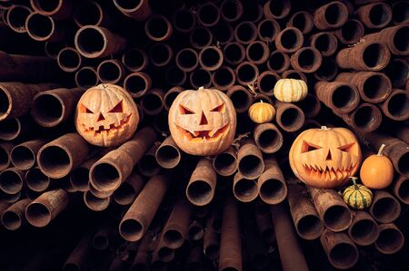Halloween Pumpkins on a stack of rusty pipes. Stock fotó