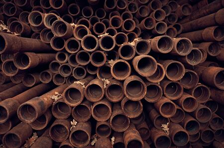 Rusty pipes background. End perspective view.