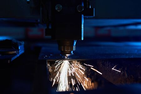 CNC Laser cutting of metal close up, modern industrial technology. Small depth of field. Stock Photo