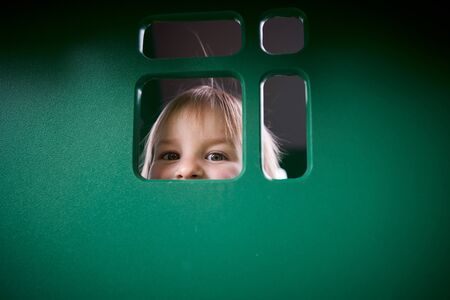 Happy 2 year old toddler playing at the playground. Фото со стока - 147261784