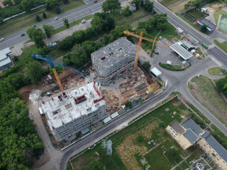 Aerial view of construction site with large crane at summer day