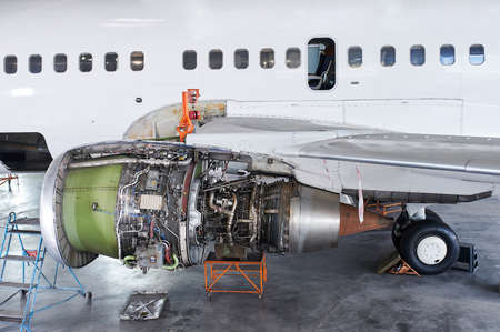 aircraft engine servicing - opened panels of a large engine of parked aircraft. nobody Фото со стока