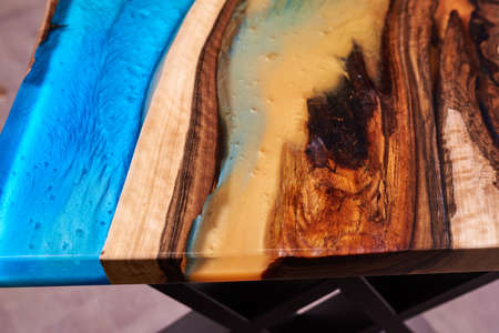 Texture of a wooden table with epoxy resin. nobody.