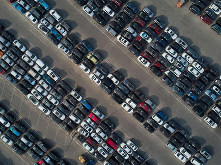 Aerial view of used wrecked automobile storage lot parking.