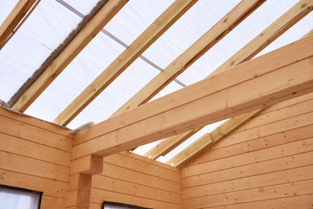 inside a wooden house under construction, no people.