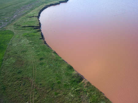 Aerial top view of a pink salt lake. Azov Ukraine