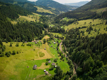 Aerial top down view of Mountain Village in Carpathians in Summer day
