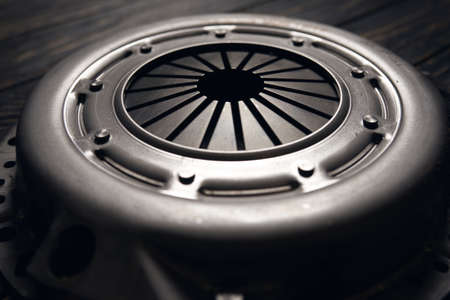 new car clutch kit on a black wooden background. Close up