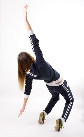 beautiful fit woman dancing in a tracksuit