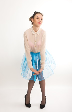 reggicalze: Full length portrait of a beautiful sexy slim model in a blue skirt and white blouse transparent, in stockings and garters Archivio Fotografico