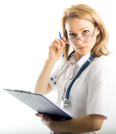 entries: beautiful young female doctor in medical gown and rubber gloves holding a medical records. nurse making entries medical records Stock Photo