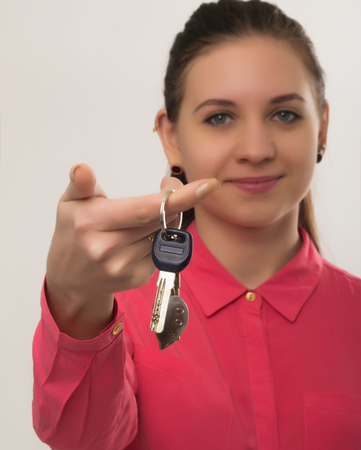 renter: beautiful woman holds the keys to the apartment