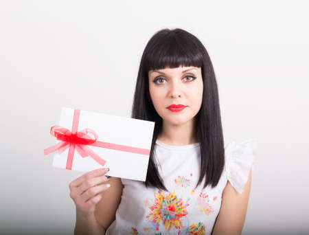 giftwrapped: beautiful girl with an envelope tied with ribbon Stock Photo