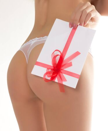 vivacious: beautiful girl in lacy shorts with an envelope tied with ribbon