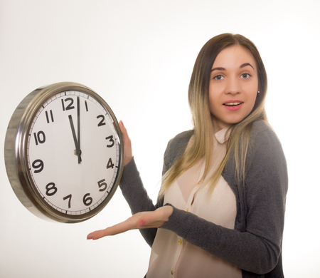 timezone: Surprise young woman looking at alarm clock with blank copy space, closeup portrait of beautiful europian woman, positive human emotion facial expression Stock Photo