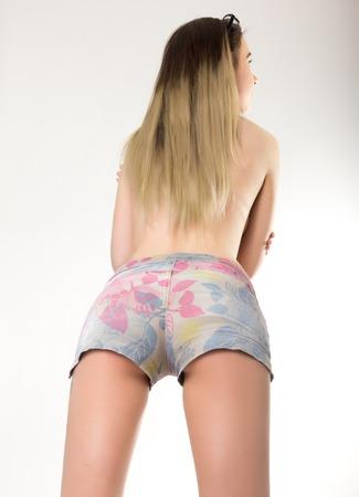blondy: slim blondy girl in colored denim shorts