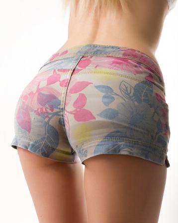 slim blondy girl in colored denim shorts