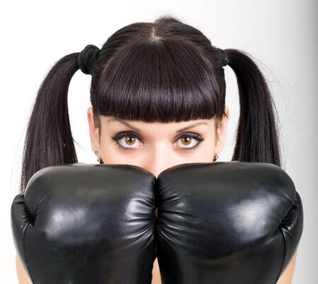 black gloves: female boxer - fitness woman boxing wearing boxing black gloves Stock Photo
