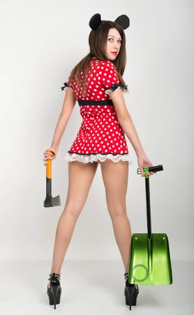 scarry: Busty beautiful young girl in a short dress with polka dots, bear in one hand and a shovel in the other ax. back view.