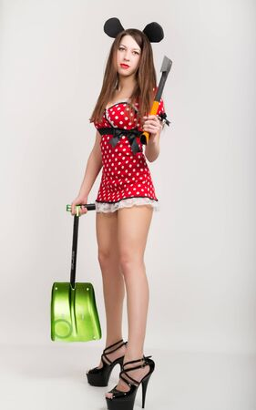 scarry: Busty beautiful young girl in a short dress with polka dots, bear in one hand and a shovel in the other ax.