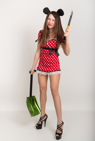 busty: Busty beautiful young girl in a short dress with polka dots, bear in one hand and a shovel in the other ax.