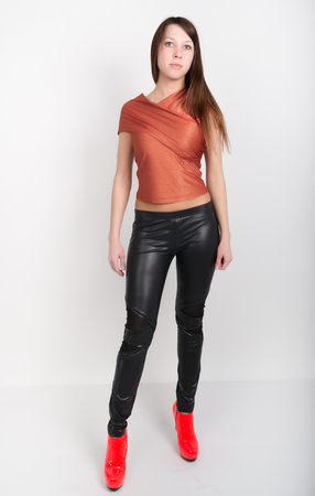 leather pants: beautiful slim girl in leather pants and red high-heeled shoes.