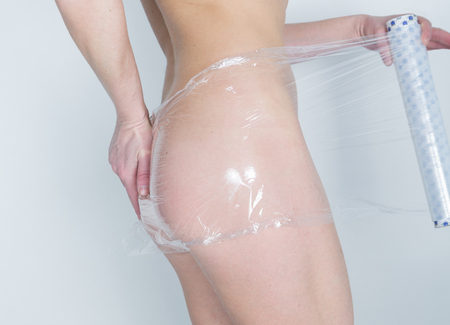 certain: Cosmetic wrap. Slimming treatment in certain parts of the body. Caring for female body. Stock Photo