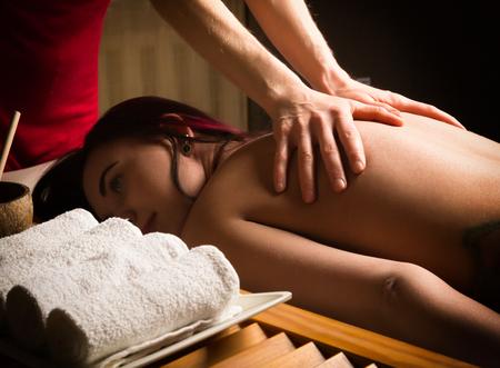 profile measurement: massage therapist at the spa salon makes cellulite massage to a patient. Beauty treatment concept.