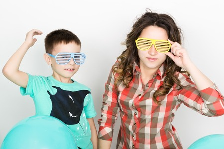 fold ones arms: brother and sister, wearing glasses in the style of disco. fold ones arms.