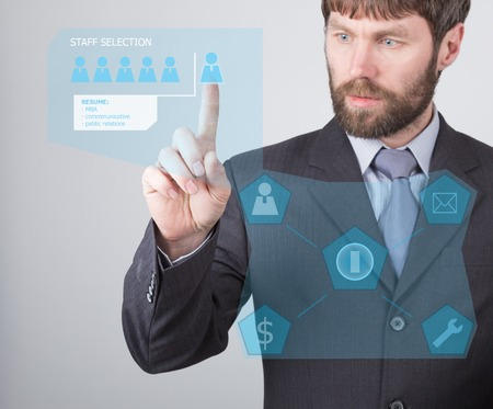 press agent: technology, internet and networking concept - businessman reading a summary of the applicant employee on virtual screens. Internet technologies in business. Stock Photo
