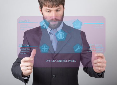 press agent: technology, internet and networking concept - businessman holding a office control panel. Internet technologies in business. Stock Photo