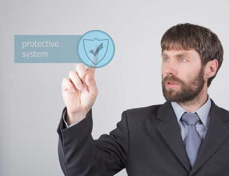 press agent: technology, internet and networking concept - Businessman presses protective system button on virtual screens. Internet technologies in business.