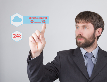 press agent: technology, internet and networking concept - businessman adjusts ambient temperature with climate control on virtual screens. Internet technologies in business.