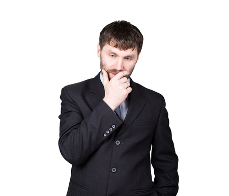nonverbal: body language. gestures distrust lies. closes mouth by hand, closed position. man in business suit isolated on white background. concept of true or false.