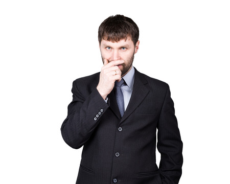 distrust: body language. gestures distrust lies. closes mouth by hand, closed position. man in business suit isolated on white background. concept of true or false.