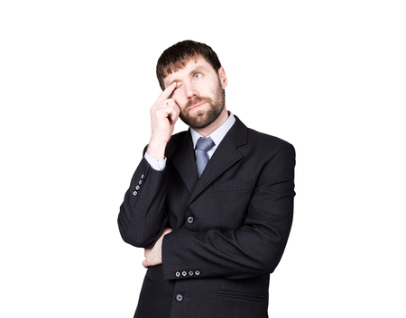 gestures distrust lies. body language. man in business suit,  finger touches the lower eyelid, eye. isolated on white background. concept of true or false.