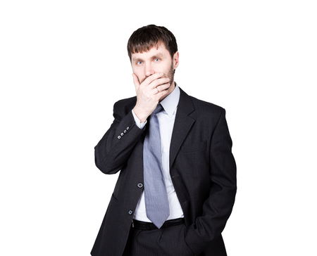 mistrust: gestures distrust lies. body language. man in business suit, hand closes his lips. isolated on white background. concept of true or false.