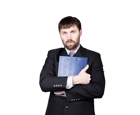 emphasis: gestures distrust lies. body language. man in business suit. closed position. emphasis thumbs. crossed arms, hugging folder with papers. isolated on white background. concept of true or false.
