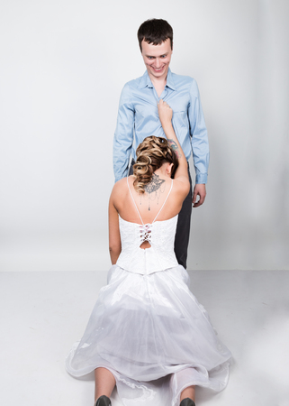 provocation: beautiful young couple in love, bride knelt before the groom. provocation playful couple.