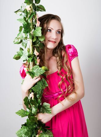 blondy: beautiful blondy girl in red dress holding on to the green vine grapes. Stock Photo