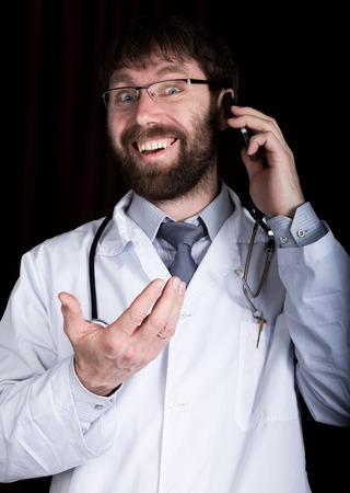 manin: Dr. bearded manin a white medical robe, stethoscope on his neck, emotionally talking on phone.