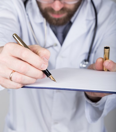 patient data: close-up hands and pen, the doctor signs a handle documents. Doctor writes medical history. write a prescription patient data history. Stock Photo